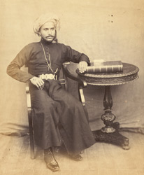 Full-length seated portrait of Saiyid Majid, Sultan of Zanzibar.
